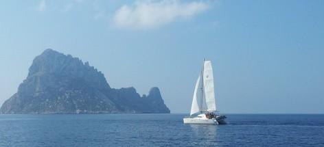 Catamaran sailing by the South East of Ibiza island