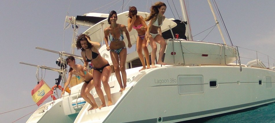 Leisure moments on board of our catamaran in Ibiza