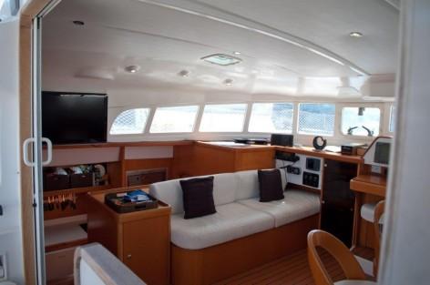 sofa and TV on catamaran in Ibiza