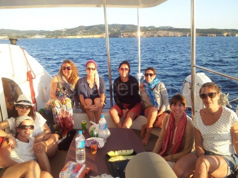 friend reunion on boat in Formentera