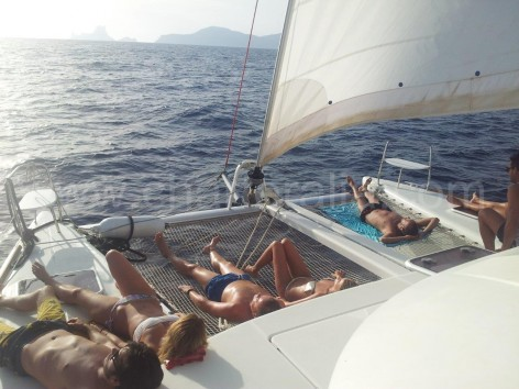 sailing around ibiza on catamaran