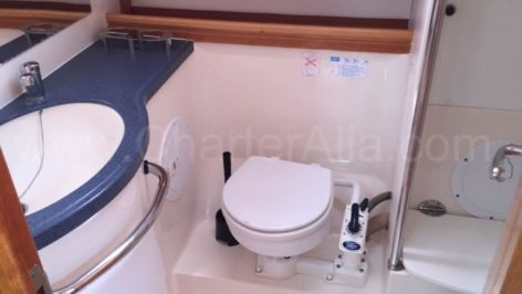 Toilet and shower in one of the two bathrooms of the Bavaria 46 sailboat