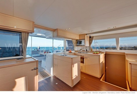 Lagoon 450 lounge and galley for rent in the Ballearic islands