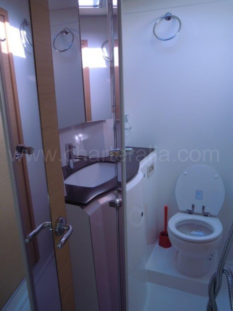 Bathroom with separate shower on board the catamaran