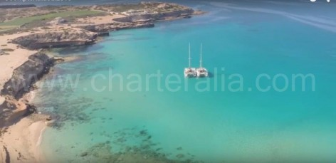 Catamarans of charteralia at Cala Conta