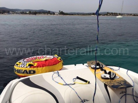 Speed boad in Ibiza with wake board and inflatable donut