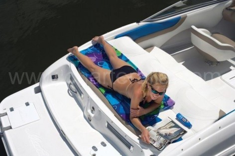 Sunbathing girl on the deck of the Mariah speed boat