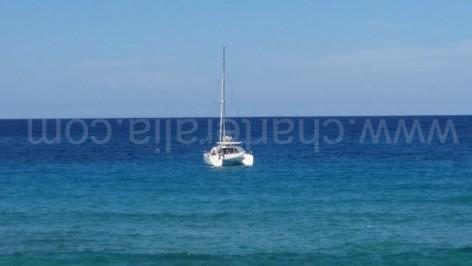 Catamaran on anchor at Cala Conta