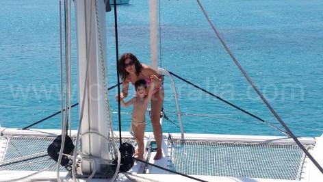 Catamaran with bow nets for rent and anchored at Cala Saona