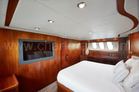 Double bedroom on board of the rental Sunseeker yacht in Ibiza