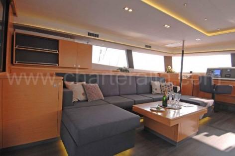 Living room on the charter Victoria 67 catamaran in Ibiza