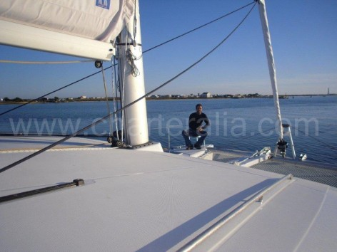 Sitting on the bow side of the catamaran Lagoon