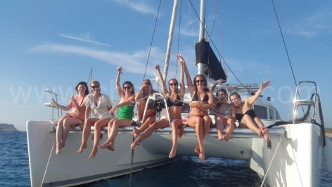 girls on catamaran in Ibiza