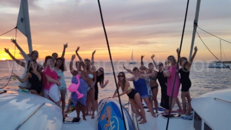 sunset in front of mambo and cafe del mar on two charter boats in Ibiza