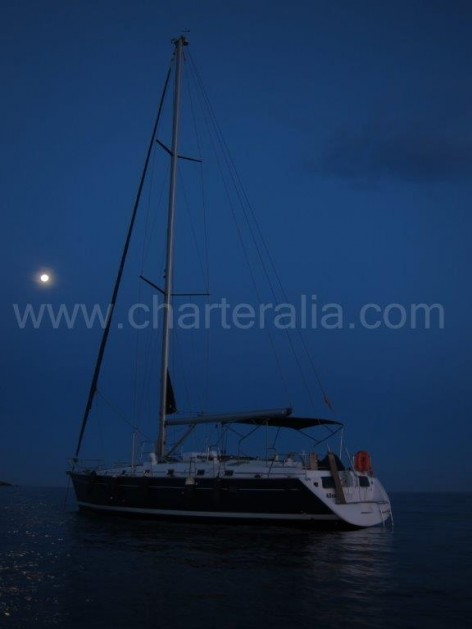 Dinner under moonlight on sailboat in Balearic Islands