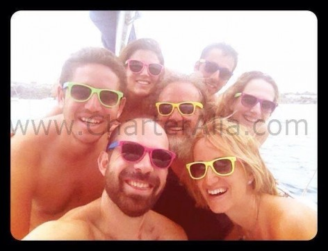 Group photo with skipper Edorta on boat rental in Balearic Islands