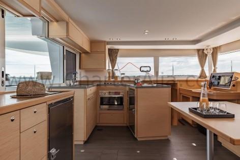 U shaped kitchen aboard 450 SportTop Lagoon boat hire in Ibiza