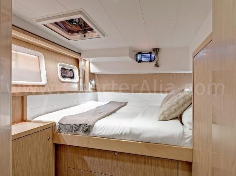 Well lit cabin of Lagoon 39 chartering yacht in Ibiza