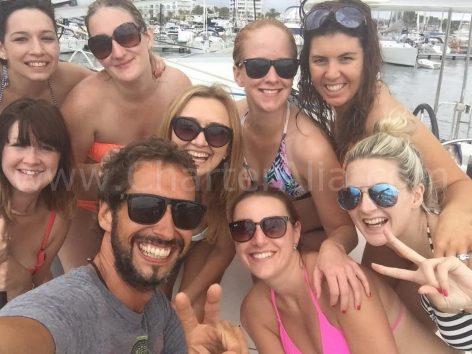 Catamaran charter in Ibiza group picture with skipper Jose