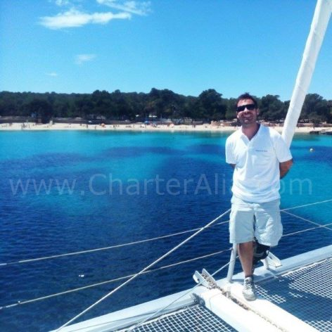 Skipper Mario of CharterAlia on board catamaran charter in Ibiza