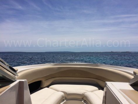 Cushioned seats on board Sea Ray 230 speed boat for hire with skipper in Ibiza