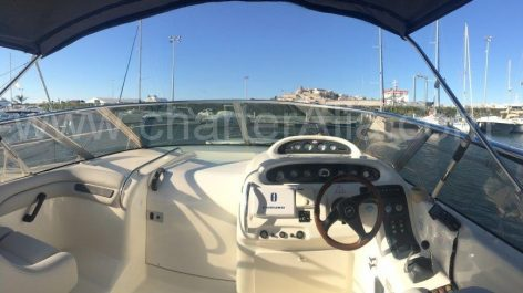 Helm of Cranchi Endurance 39 power yacht chartering in Ibiza for full day excursion