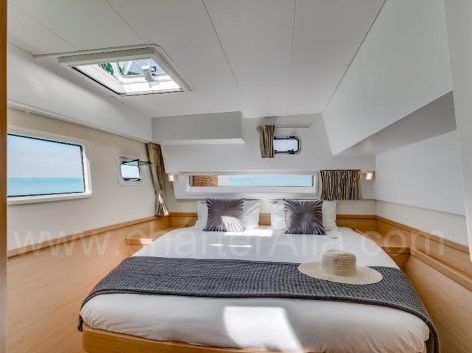 Illuminated cabin of Lagoon 42 chartering yacht in Ibiza