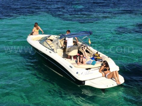 Sunbathing on board 230 Sea Ray speed boat for renting in Ibiza with captain