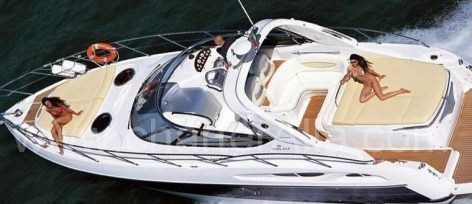 Sunbathing on board 39 Cranchi Endurance speed boat for renting in Ibiza with captain