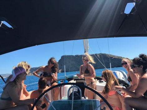 Group of girls in bikini in Ibiza on sailing boat