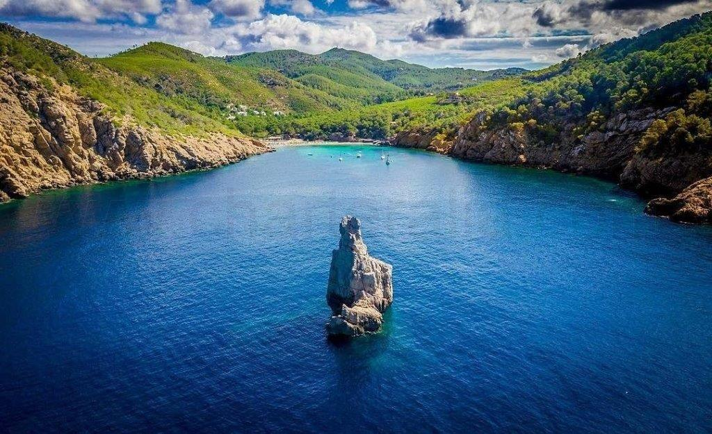 Cala Benirras Ibiza - CharterAlia boat hire Ibiza
