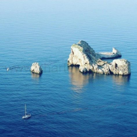 Aerial view of boat charter Ibiza enroute from Ses Margalides islands