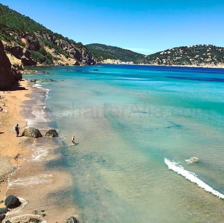 Waves and clear waters at Aguas Blancas beach in Ibiza