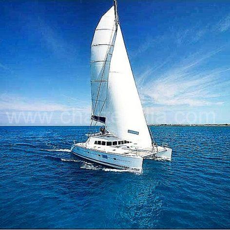 Drone view of Lagoon 470 catamaran at full sail during week long holiday in the Mediterranean sea