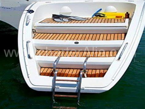 Lagoon 470 catamaran boat charter in Eivissa with comfortable steping platform and swimming ladder