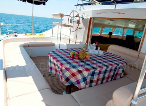 Large cockpit with dining table on catamaran 470 Lagoon sailing yacht rental in Ibiza