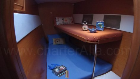 Triple cabin at bow with bunk beds in the Lagoon 470 child friendly catamaran charter in Ibiza