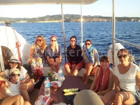 Clients in the cockpit of the charter Lagoon 380 2018 catamaran Ibiza Formentera