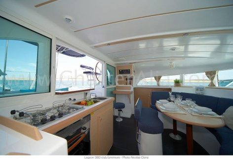 Lagoon 380 2018 catamaran rental in Eivissa living area with integrated kitchen