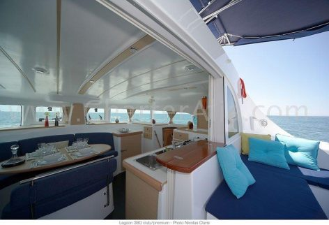 Living area and terrace of the brand new catamaran Lagoon 380 2018 for rent in Ibiza