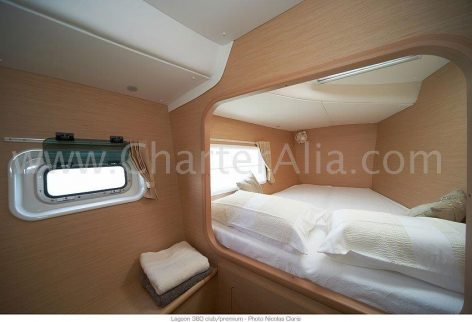 One of the cabins at the bow of this Lagoon 380 2018 catamaran for hire in Ibiza
