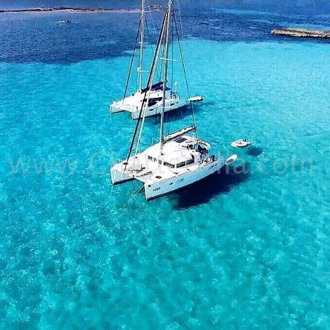 Two Lagoon 380 2018 catamarans hired with skipper in Cala Conta