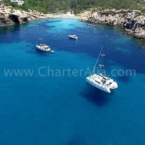 Anchored in Cala Es Codolar with our Lagoon 380 2018 catamaran rental in Ibiza with skipper