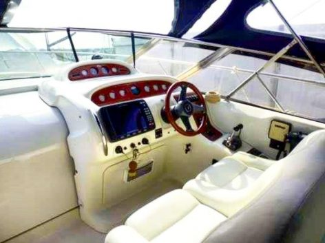 Helm of Cranchi 39 yacht in Formentera and Ibiza for rent