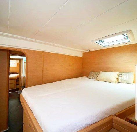 Rent a catamaran in Ibiza Lagoon 420 elevated bed forward stateroom
