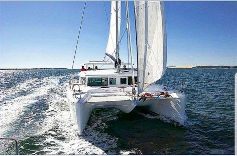 Rental catamaran in Ibiza Lagoon 420 front view with trampoline