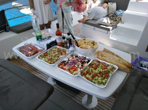 A cold lunch prepared by hostess cook on board a rental boat in Ibiza and Formentera