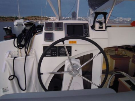 Helm of our catamaran rental in the Balearic Islands