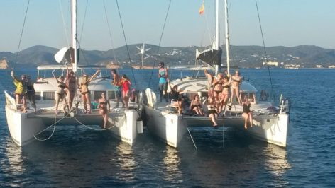 Large groups on board catamaran in Ibiza