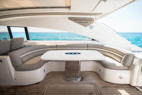 Exterior dining area on the Princess V65 luxury yacht